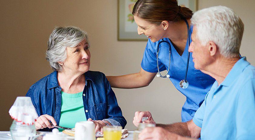 assisted care caregiver reassuring senior